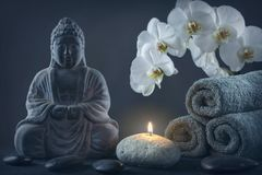 Buddha statue ,towels and stones. On a black background stock images
