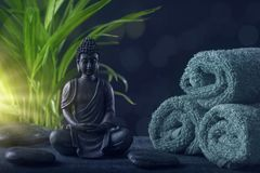 Buddha statue ,towels and stones. On a black background stock photos