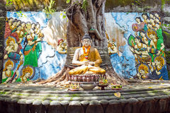 Buddha statue under the Bodhi tree in Bali Indonesia Royalty Free Stock Photography