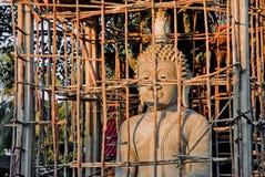 Buddha statue under construction on sunshine royalty free stock photography