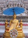The Buddha statue under the umbrella Royalty Free Stock Image
