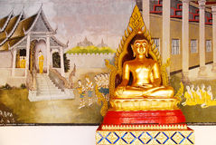 Buddha statue and wall painting Stock Photos