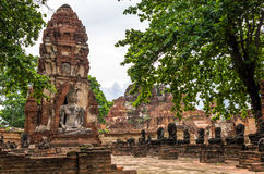 Buddha statue in Wat Mahathat, a ruined temple in Ayuthaya, Thai Stock Photo