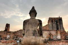 Buddha Statue at Wat Mahathat and the sky,Thailand. Back of the Buddha Statue at Wat Mahathat (World Heritage) Ayutthata Historic Park, Thailand Stock Photo