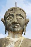 Buddha statue in Wat Piyawat temple in Muang Khoun, Laos. Stock Image