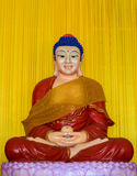 Buddha statue Wearing a red robe Stock Images