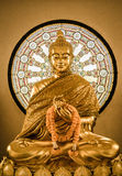 Buddha statue and Wheel of life Stock Images