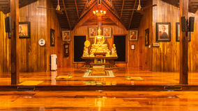 Buddha statue in wooden church at Thai temple, Tha Stock Photo