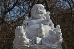 Buddha statue in the woods at a buddhist mediata Stock Images