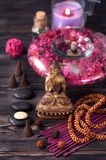 Buddha statue, zen stones and incense. concept of meditation, Spa and Zen Stock Images