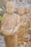 Buddha statues. Are walking alms round stock image