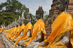 "Buddha statues. In a row at ""Wat Yai-Chaimongkol"" Buddhist temple in Ayutthaya - Thailand Royalty Free Stock Images"
