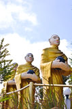 Buddha statues are alms round. And blue sky royalty free stock images