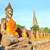 A row of ancient buddha statues Stock Photos