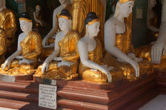 Buddha statues in Bhumiparsa Mudra position Stock Photos