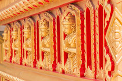 Buddha statues on Buddhist temple wall Royalty Free Stock Image