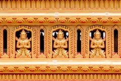 Buddha statues on Buddhist temple wall Stock Image