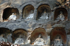 Buddha statues carved in rock Royalty Free Stock Image