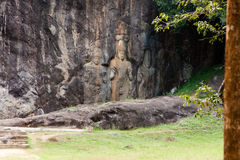 Buddha statues carved in rock at Buduruvagala temple in Sri Lank Royalty Free Stock Photos