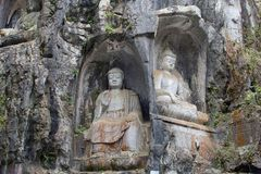 Buddha statues, carved in the rocks in the Confucian Lingyin temple, Hangzhou, China Stock Images
