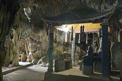 Buddha Statues in Cave. Ancient Buddha statues inside the caves at Bich Dong temple near Ninh Binh in Vietnam Stock Photo