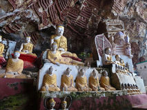 Buddha Statues in Cave in Myanmar (Burma). Numerous Buddha statues line the walls and adorn the sides of this holy cave in Burma, Myanmar, Southeast Asia. The Royalty Free Stock Photo