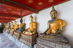 Buddha statues with cloths at the Wat Pho temple Stock Photo