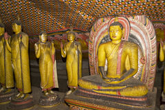Buddha Statues at Dambulla Rock Temple. Image of Buddha statues in a cave at the ancient Rock Temple, Dambulla, Sri Lanka. This is a UNESCO World Heritage Site Stock Photos