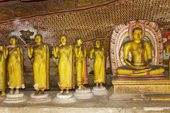 Buddha Statues at Dambulla Rock Temple, Sri Lanka. Image of Buddha statues in a cave at the ancient Rock Temple, Dambulla, Sri Lanka. This is a UNESCO World Royalty Free Stock Images
