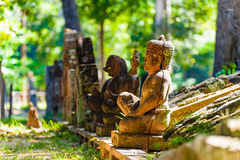 Buddha Statues in forest Stock Images