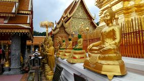 Buddha statues in front of Pratart Doi suthep Stock Photo