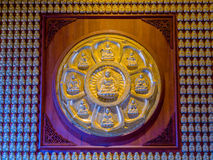 9 Buddha statues in golden painted lotus leaf stucco. Stock Photography