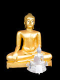 Buddha statues. The Golden and the smaller white one sit together face to face Royalty Free Stock Photo