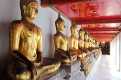 Buddha Statues at the Grand Palace, Bangkok. Gold Buddha statues in Wat Pho at the Grand Palace of Bangkok stock photos