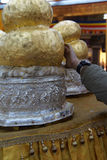 Buddha statues hidden under thick gold leaf Stock Photos
