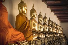 Buddha statues ina  row at Wat Arun in Bangkok, Thailand. Royalty Free Stock Photo
