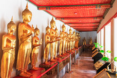 Buddha statues inside the Wat Pho temple, known also as the Temple of the Reclining Buddha Royalty Free Stock Image