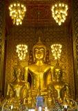 Buddha statues inside Wat Phrathat Hariphunchai, Thailand Stock Photo