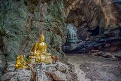 Buddha statues in Khao Luang Cave - Phetchaburi, Thailand. The golden Buddha statues in Khao Luang Cave - Phetchaburi, Thailand stock photos