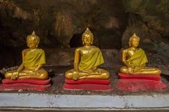 Buddha statues in Khao Luang Cave - Phetchaburi, Thailand. The golden Buddha statues in Khao Luang Cave - Phetchaburi, Thailand stock photography