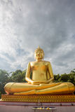 Buddha statues, large golden yellow. Against a backdrop of brigh Stock Photos