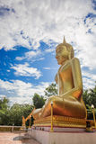 Buddha statues, large golden yellow. Against a backdrop of brigh Stock Photography