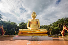 Buddha statues, large golden yellow. Against a backdrop of brigh Royalty Free Stock Image