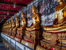 Buddha Statues in line. Royalty Free Stock Photography