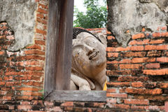 Buddha statues looked through the window Stock Image