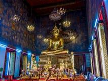 Buddha statues with mural painting around. Stock Image