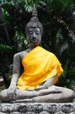 Buddha statues with orange bands Royalty Free Stock Photos
