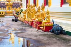 Buddha statues outside Wat Pha That Luang in Vientiane, Laos Stock Photo