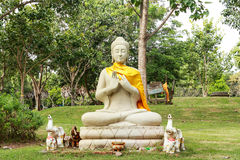 Buddha statues. In the park, outdoors under the shade trees at Wat Phra That Na Dun.,  Province Mahasarakham , Thailand Royalty Free Stock Photography