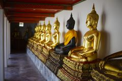 Buddha statues in a row at Wat Pho Stock Photos